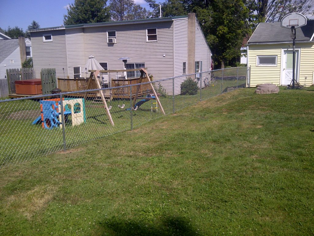 family at peace of mind with poly enterprises fence enclosed yard